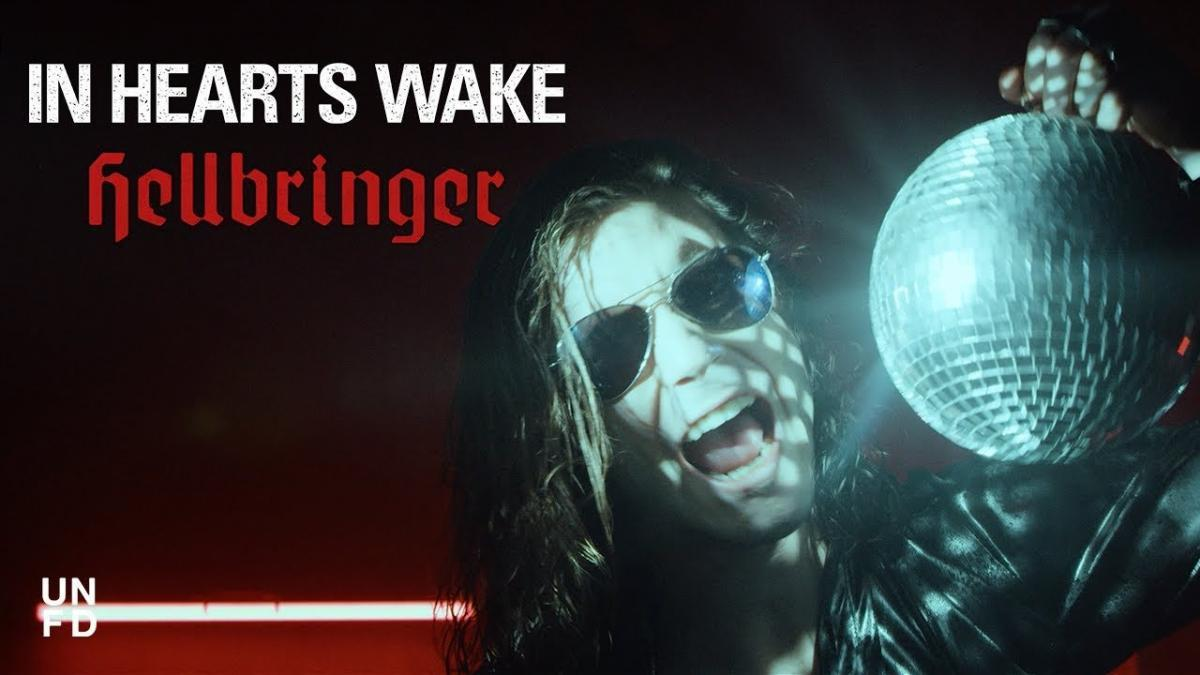 In Hearts Wake sort la chanson Hellbringer, en featuring avec Jamie Hails de Polaris